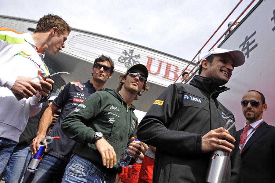 Paul Di Resta, Mark Webber, Jarno Trulli and Tonio Liuzzi head to the drivers parade