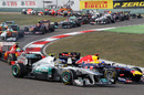 Sebastian Vettel keeps Nico Rosberg at bay in to turn two