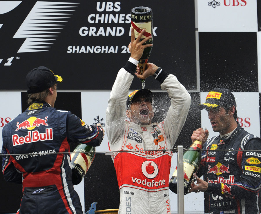 Lewis Hamilton celebrates victory on the podium
