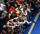 Lewis Hamilton celebrates victory with his team in parc ferme