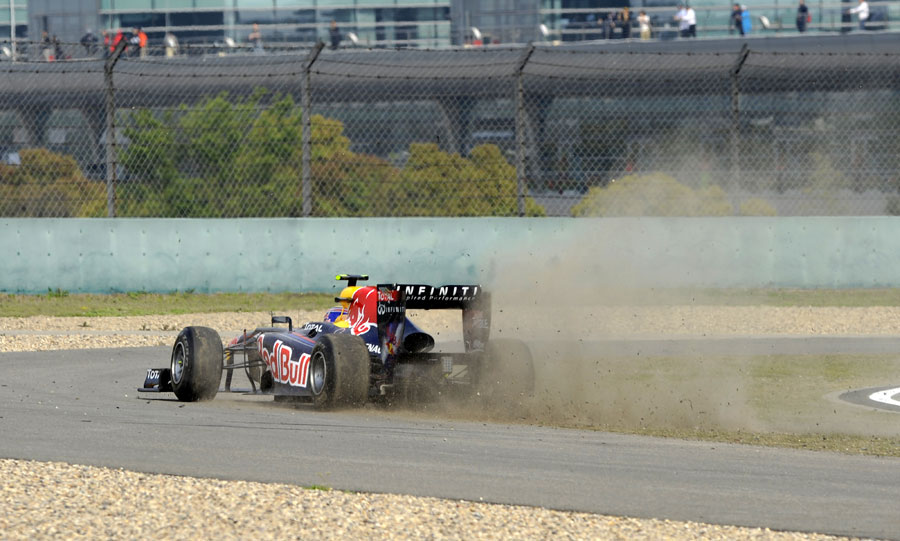 Mark Webber runs wide at turn one