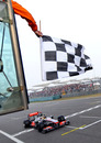 Lewis Hamilton takes the chequered flag to win