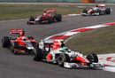 Tonio Liuzzi leads the two Virgins and his team-mate Narain Karthikeyan