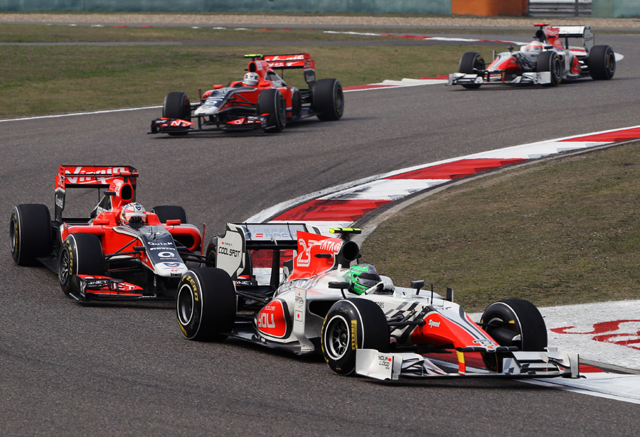 Tonio Liuzzi leads the two Virgins and his team-mate Narain Karthikeyan