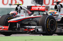 The McLarens of Jenson Button and Lewis Hamilton go wheel-to-wheel over second place