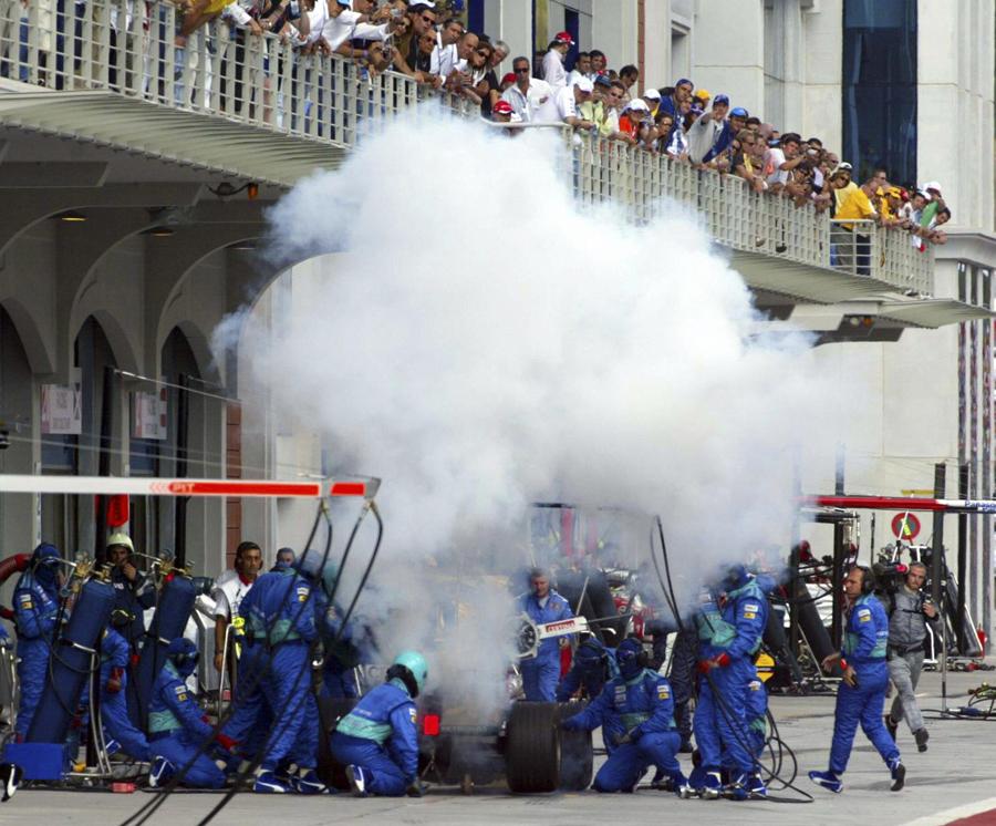 Felipe Massa's Sauber burns in the pits