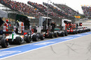 The queue at the end of the pit lane during Q2