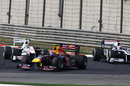Mark Webber picks his way through the field