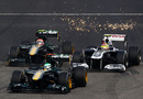 Sparks fly as Jarno Trulli and Heikki Kovalainen take on Pastor Maldonado