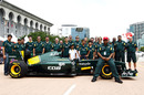 Tony Fernandes poses for photos with the rest of the Lotus team