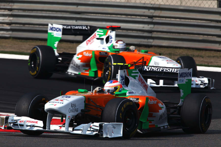 Paul di Resta leads Adrian Sutil round the hairpin