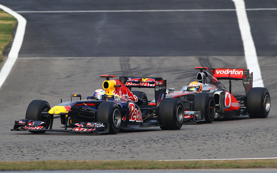 Lewis Hamilton hustles Sebastian Vettel late in the race