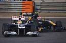 Jarno Trulli puts pressure on Pastor Maldonado