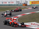 Timo Glock leads the battle of the backmarkers