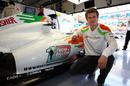 Nico Hulkenberg shows off the Force India 'One from a billion' search being displayed on the car