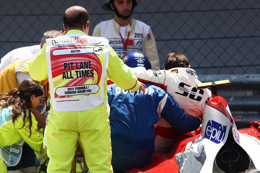 Davide Rigon is lifted out of his car after an accident with Julian Leal