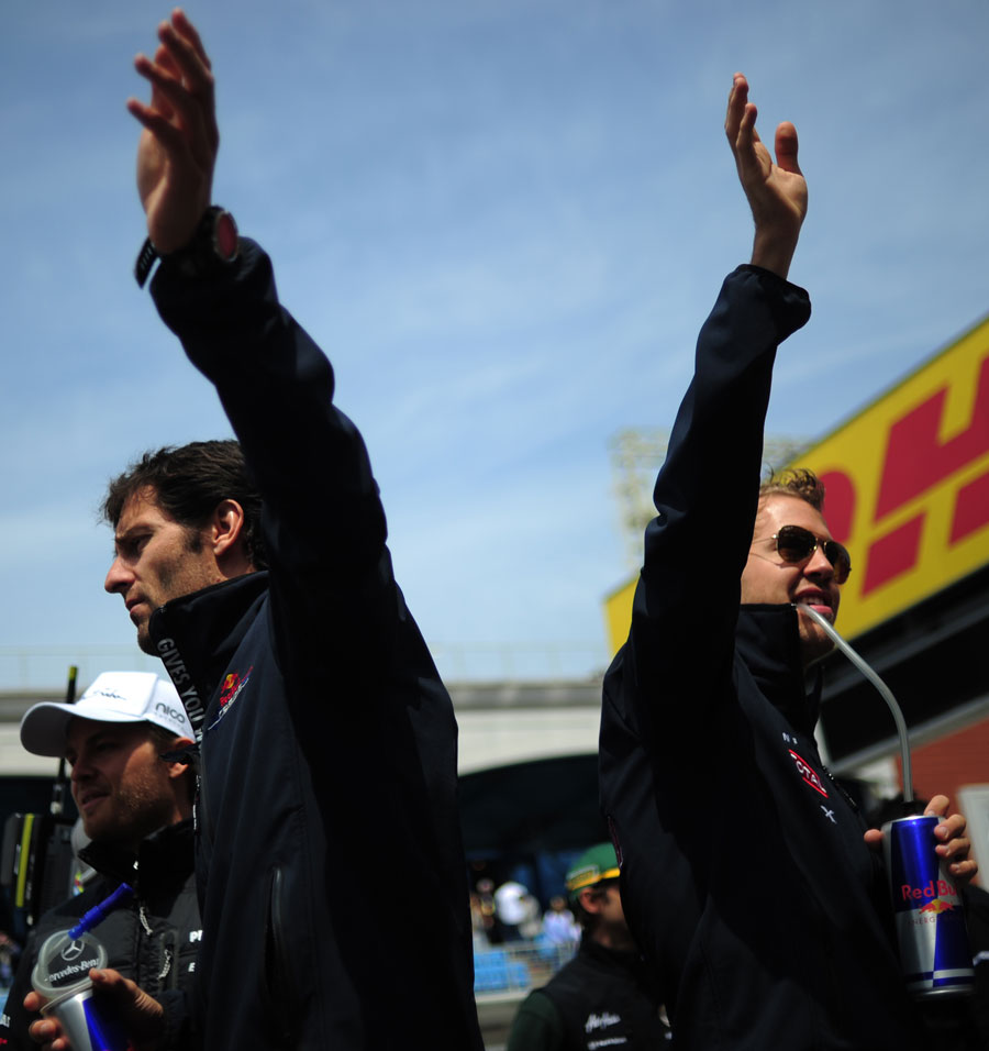 Mark Webber and Sebastian Vettel wave to the fans