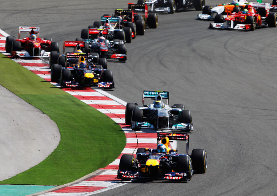 Sebastian Vettel leads the pack through the first two corners