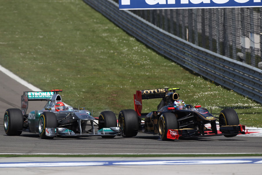 Michael Schumacher and Vitaly Petrov come together in turn 12
