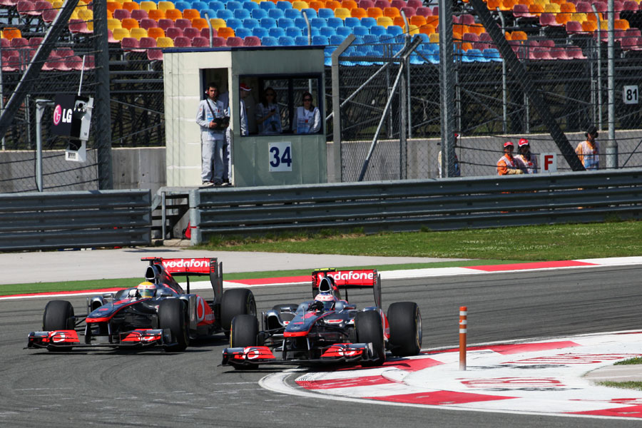 Jenson Button holds off his team-mate Lewis Hamilton