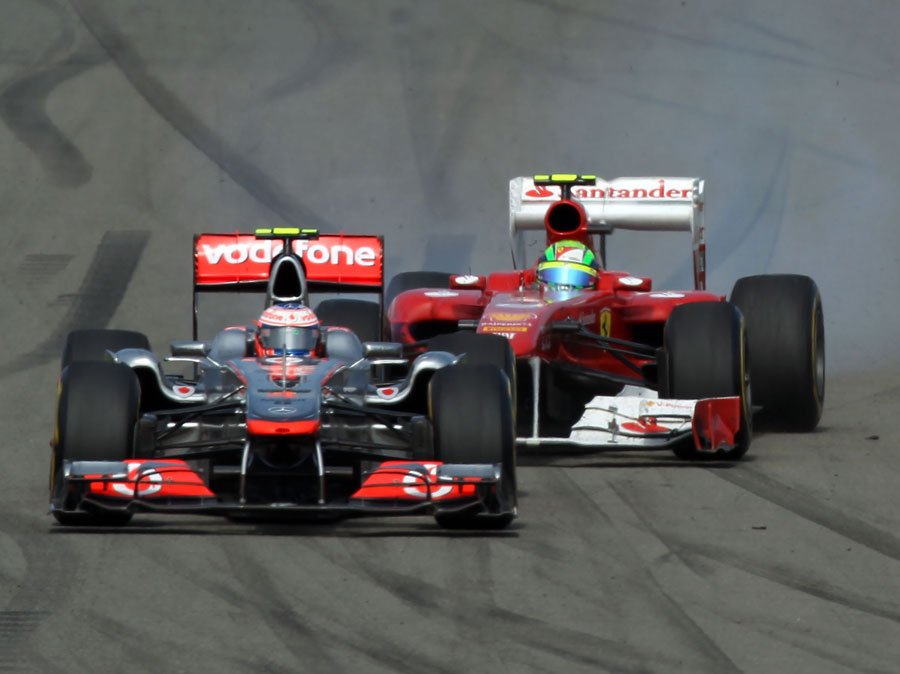Felipe Massa narrowly avoids an accident with Jenson Button