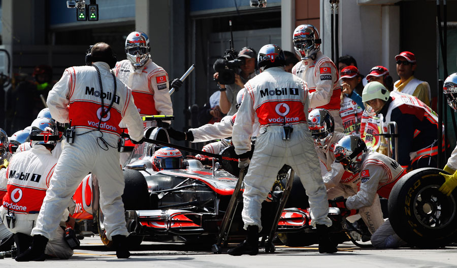 Jenson Button pits for a new set of soft tyres