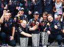 Sebastian Vettel and Mark Webber celebrate with Christian Horner, Adrian Newey and the rest of the Red Bull team