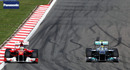 Nico Rosberg defends from Fernando Alonso
