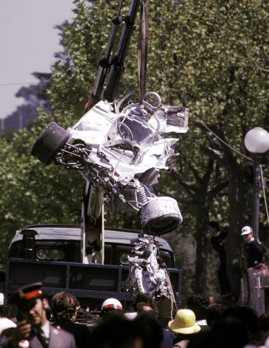 The remains of Rolf Stommelen's Embassy Hill is lifted out of the spectator area after a high-speed accident killed five people