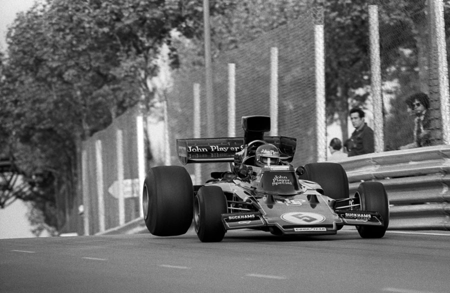 Ronnie Peterson takes on the jump midway down the pit straight