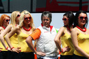 Force India mechanic Neil Dickie poses with the grid girls