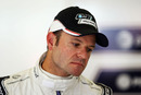 Rubens Barrichello waits patiently in the Williams garage on Friday