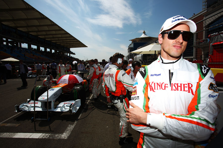 Adrian Sutil waits on the grid