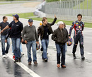 Bernie Ecclestone leads a track walk of the newly-renovated Red Bull Ring