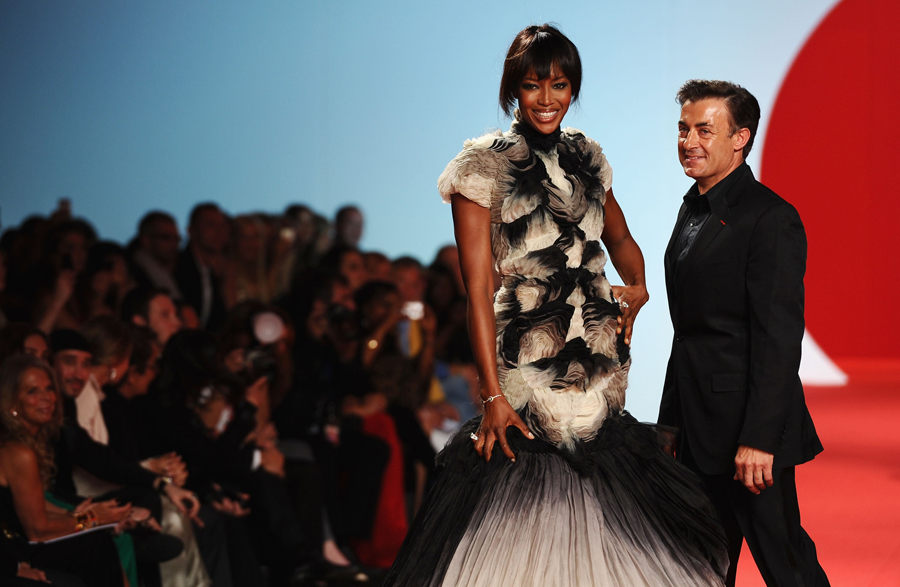 Model Naomi Campbell and former Formula One driver Jean Alesi attend Fashion For Relief at Forville market during the 64th Annual Cannes Film Festival