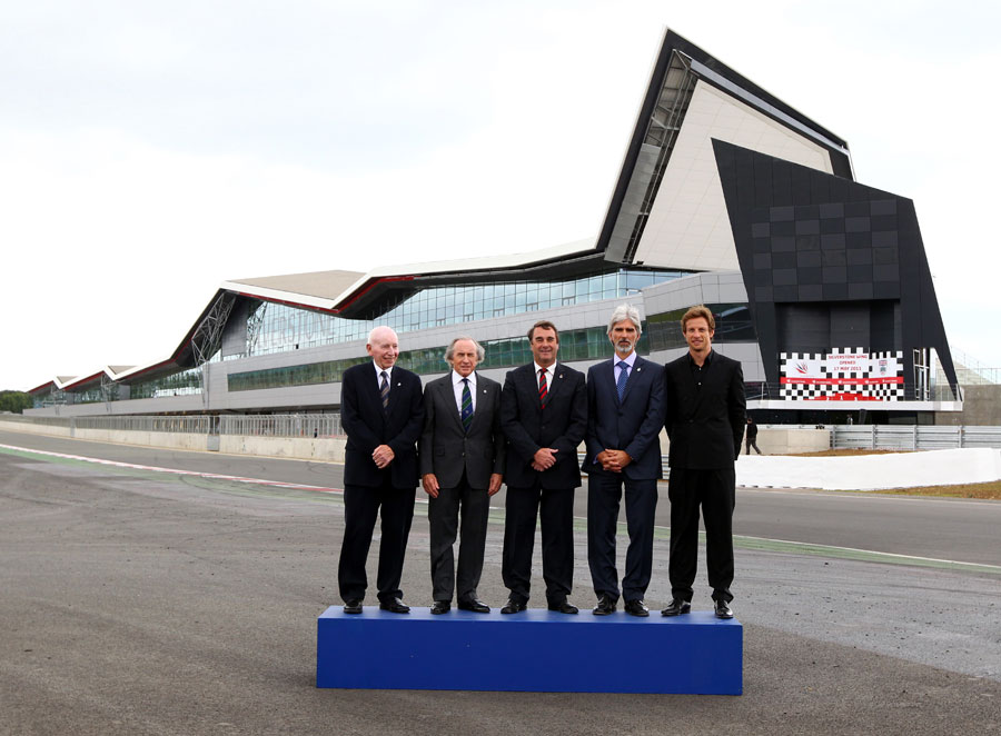 British world champions pose for a photo at the official opening of the new £27 million pit and paddock complex