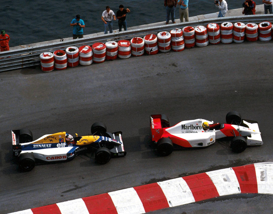 Ayrton Senna holds off Nigel Mansell for the lead
