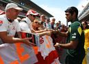 Karun Chandhok signs autographs for fans at the circuit on Thursday
